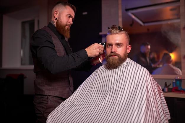 Handsome caucasian man at the hairdresser in barber shop