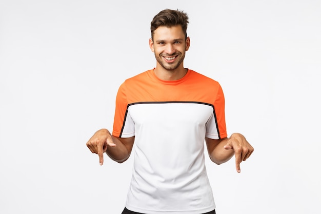 Handsome cheeky, masculine hispanic sportsman in sports t-shirt, wearing activewear