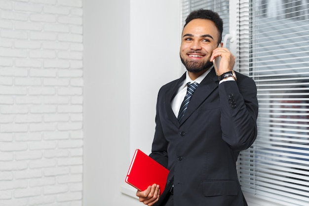 Handsome cheerful african american executive business man