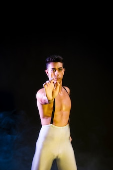 Handsome contemporary dancer performing in spotlight
