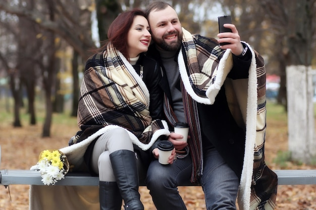 Handsome couple in love date with flower in autumn park