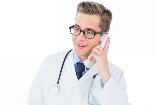 Handsome doctor talking on phone