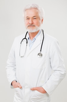 Handsome elderly doctor in uniform