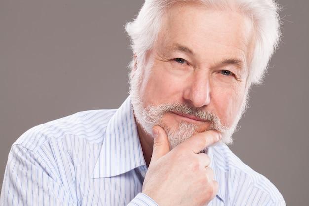 Handsome elderly man with grey beard