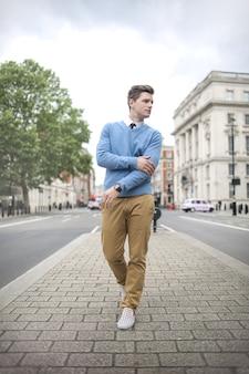 Handsome elegant guy walking on the street