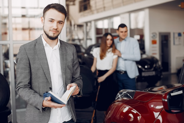 Handsome and elegant man in a car salon