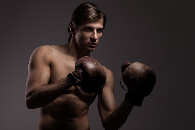 Handsome guy in a boxing gloves