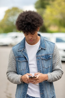Handsome guy looking at the mobile