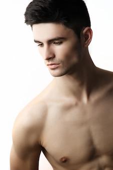 Handsome guy model naked torso portrait