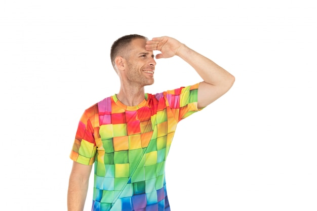 Handsome guy with colored tshirt looking something
