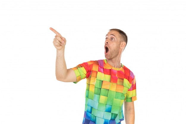 Handsome guy with colored tshirt pointing something with his hands
