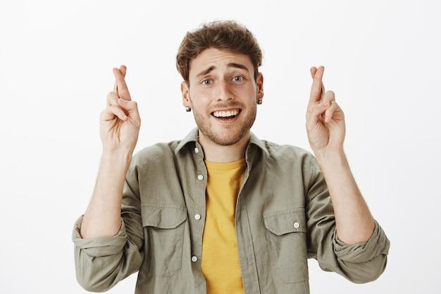 Handsome happy man posing in the studio