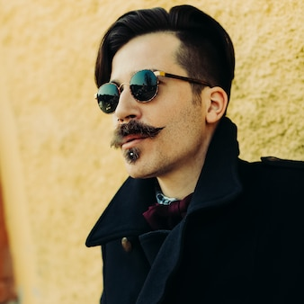 Handsome hipster man. trendy autumn look. urban vintage style