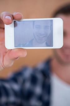 Handsome hipster taking selfie