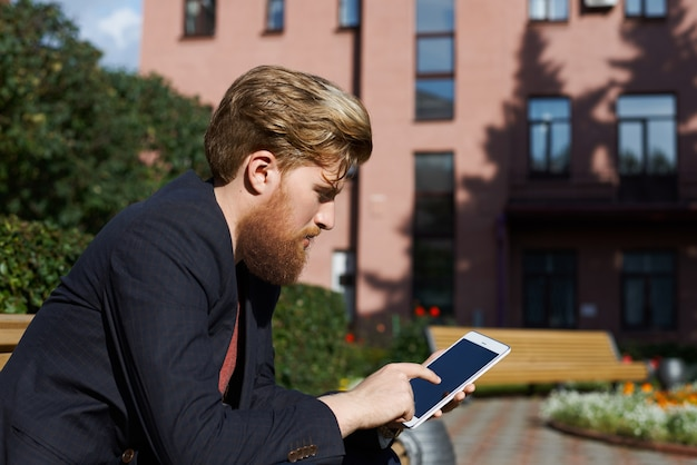 Handsome hipster use tablet for search a job