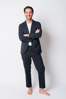 Handsome hispanic businessman wearing suit