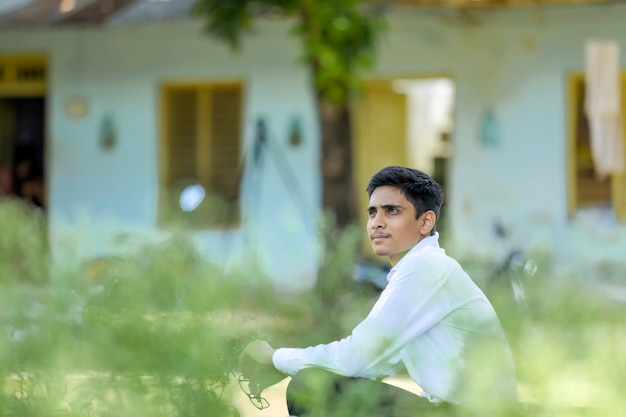 Handsome indian young boy wearing white shirt