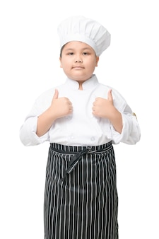 Handsome kid hispanic chef giving the thumbs up to one of his dishes isolated on white background.