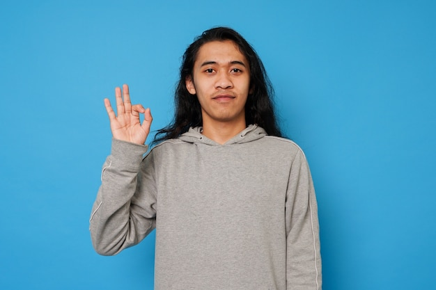 Handsome long hair man on isolated background
