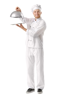 Handsome male chef with tray and cloche on white background