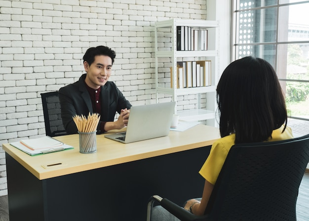 Handsome male company manager interviewing female