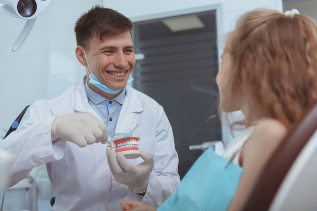 Handsome male dentist working at his clinic