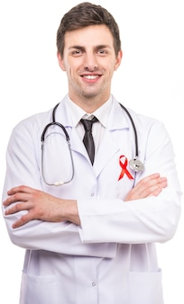 Handsome male doctor with red ribbon as a symbol of aids.