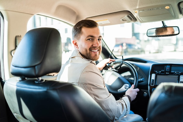 Handsome male driver looking back