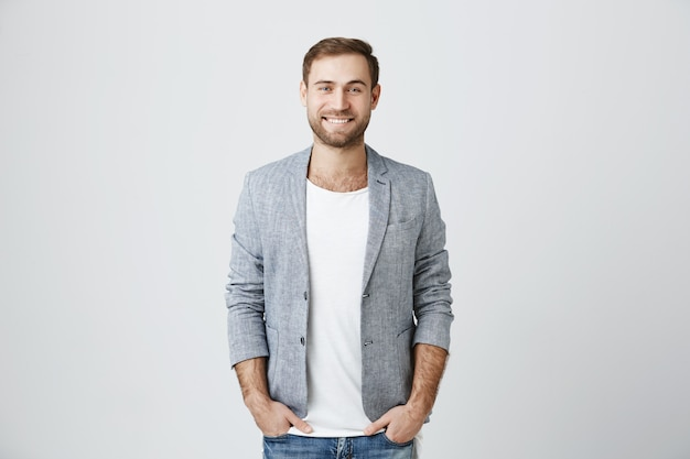 Handsome male entrepreneur smiling cheerful