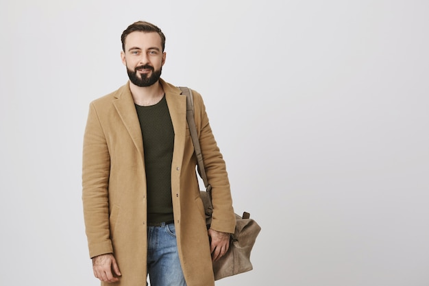 Handsome male entrepreneur in trench coat