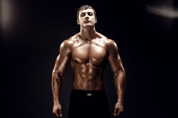 Handsome male model posing on black