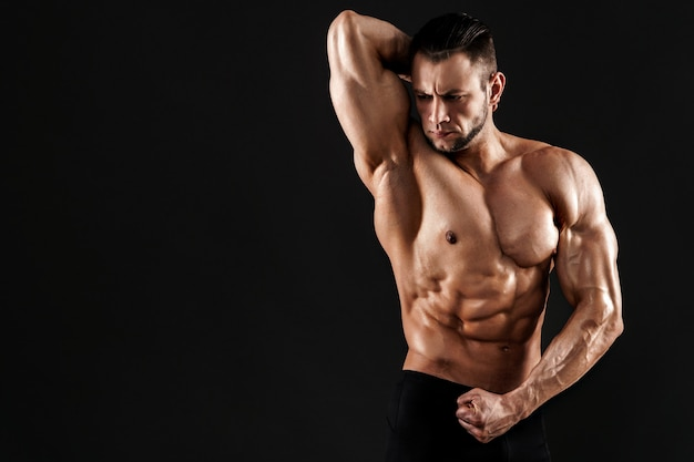 Handsome male model posing at studio.