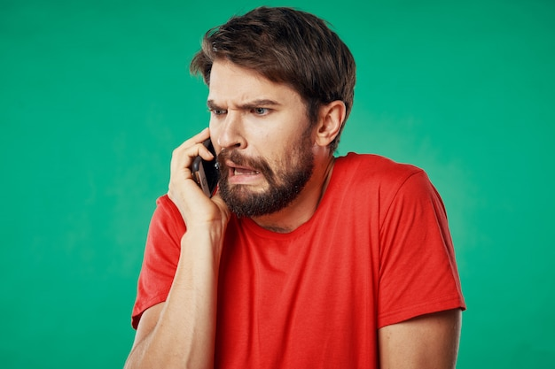 Handsome male model with beard with a phone posing