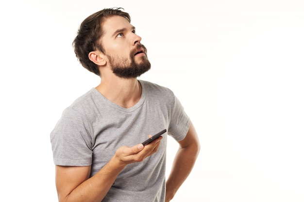 Handsome male model with beard with a phone posing in