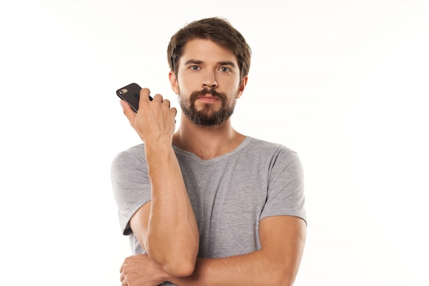 Handsome male model with beard with smartphone