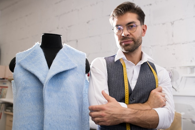 Handsome male tailor posing