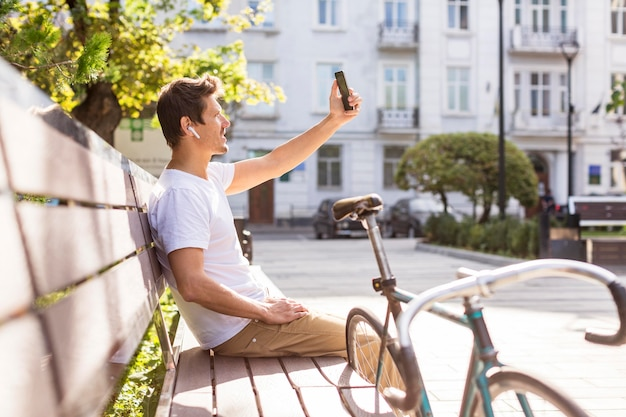Handsome male taking a selfie outdoors
