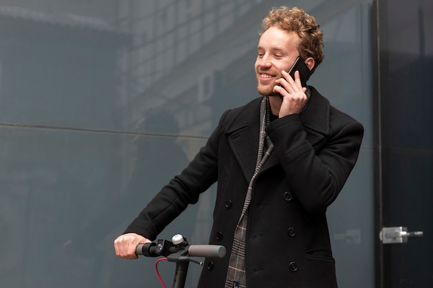 Handsome male talking on the phone