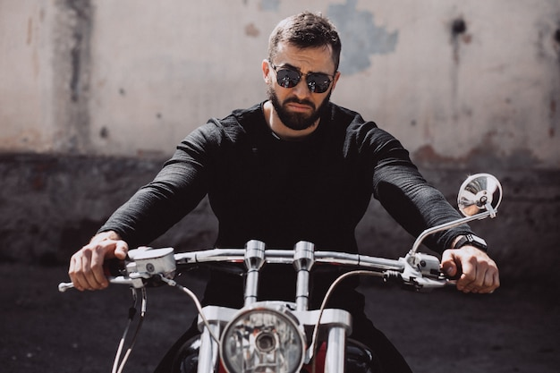 Handsome man biker travelling on mototrcycle