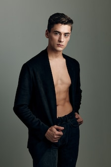 Handsome man black jacket nude torso modern style self-confidence.