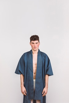 Handsome man in blue robe with white background