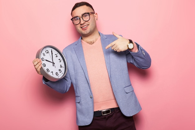 Handsome man in bright jacket with clocks