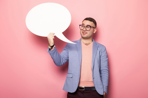 Handsome man in bright jacket with speech bubble