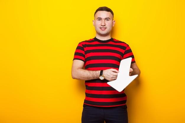 Handsome man in bright t-shirt with speech pointer