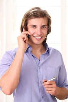 Handsome man calling by cell phone