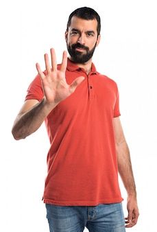 Handsome man counting five