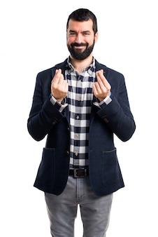 Handsome man doing a money gesture