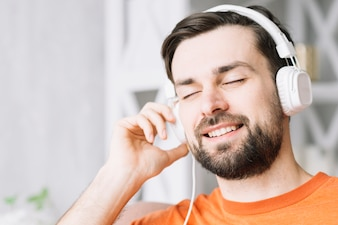 Handsome man enjoying music