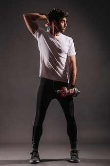 Handsome man exercising with dumbbells
