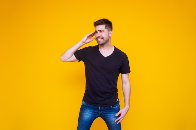 Handsome man forgotten and confused on yellow background